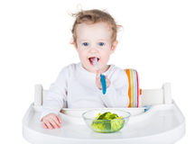 Cute funny baby eating broccoli Royalty Free Stock Photos