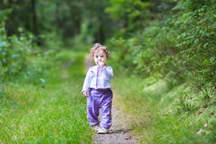 Cute funny baby girl in beautiful autumn pine forest Stock Photo