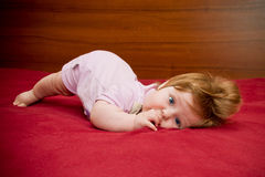 Cute funny baby girl with cheerful coiffure Royalty Free Stock Images