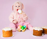 Cute funny baby girl in a costume of Easter bunny rabbit with ea Royalty Free Stock Images