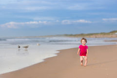 Free Cute Funny Baby Girl Running On Beautiful Beach Stock Photography - 41377712