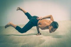 Cute funny boy in dance studio - Young man break dancing. Cute funny boy in dance studio stock photography