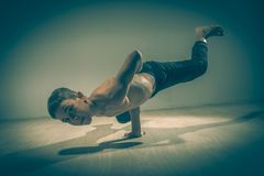 Cute funny boy in dance studio - Young man break dancing. Cute funny boy in dance studio royalty free stock image