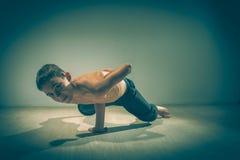 Cute funny boy in dance studio - Young man break dancing. Cute funny boy in dance studio royalty free stock photography
