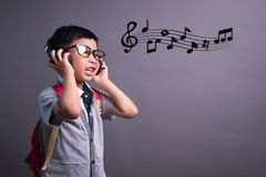 Cute funny children in dance studio, Cute little boy in headphones listening to music on color background royalty free stock photos