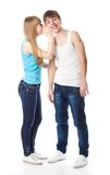 Cute funny couple in secret communication Stock Images