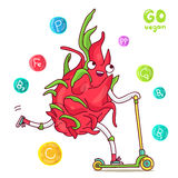 Cute and funny dragon fruit rides a scooter Stock Photo