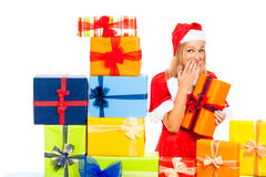 Cute funny female Christmas Santa with gift Royalty Free Stock Photos