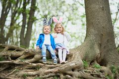 Cute funny girl and boy with Easter eggs at park. easter concept. Children playing with easter eggs on Easter day stock photography