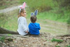 Cute funny girl and boy with Easter eggs at park. easter concept. Children playing with easter eggs on Easter day stock image