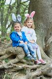 Cute funny girl and boy with Easter eggs at park. easter concept. Children playing with easter eggs on Easter day royalty free stock image