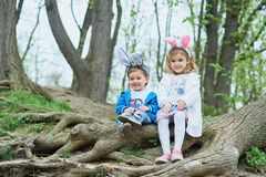 Cute funny girl and boy with Easter eggs at park. easter concept. Children playing with easter eggs on Easter day royalty free stock photos
