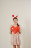 Cute funny girl holding red balloon heart Stock Photography