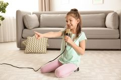 Cute funny girl with microphone royalty free stock photos