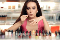 Cute Funny Girl Painting Her Nails royalty free stock photos