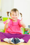 Cute funny girl showing thumbs up Royalty Free Stock Images