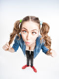Cute funny girl with two pony tails cross looking - wide angle shot Stock Photography