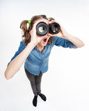 Cute funny girl with two pony tails looking thru photo lenses- wide angle Stock Photography
