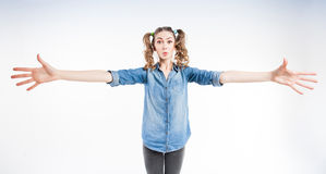 Cute funny girl with two pony tails showing how big it is - wide angle Royalty Free Stock Photos