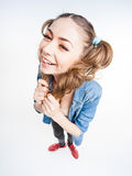 Cute funny girl with two pony tails smiling - wide angle Royalty Free Stock Photography