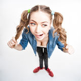 Cute funny girl with two pony tails - wide angle shot Stock Image