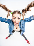 Cute funny girl with two pony tails - wide angle shot Stock Photos