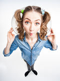 Cute funny girl with two pony tails - wide angle shot Stock Photo