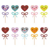 Cute funny kawaii Colorful Sweet Cake pops hearts set with bow. Isolated on white background. Vector illustration Stock Photo