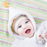 Cute funny laughing baby girl on colorful blanket Royalty Free Stock Images