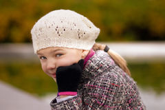 Cute funny little blonde girl in white beret Stock Image