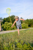 Cute funny little boy running to catch butterflies Stock Photography