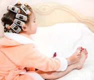 Cute funny little girl polishing her nails Stock Image