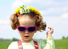 Cute funny little girl in sunglasses Royalty Free Stock Photography