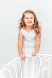 Cute, funny little girl in white. Studio portrait Royalty Free Stock Photography