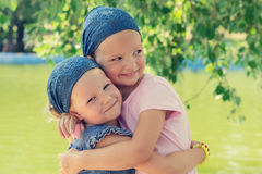 Cute funny little girls (sisters) smile. Selective focus. Royalty Free Stock Image