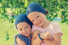 Cute funny little girls (sisters) smile. Selective focus. Royalty Free Stock Photo