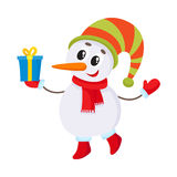 Cute and funny little snowman decorating a Christmas tree Stock Images