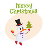 Cute and funny little snowman decorating a Christmas tree Royalty Free Stock Image