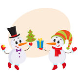 Cute and funny little snowman holding a gift box, vector illustration Royalty Free Stock Images