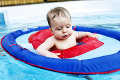 Cute funny little toddler girl in swimming pool Royalty Free Stock Photography