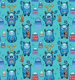 Cute monsters seamless pattern on a blue background. Vector cartoon characters with blue yetis fun and play vector illustration
