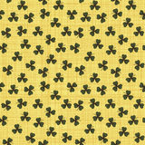 Cute funny seamless background pattern with green clover leaves. Isolated on the yellow canvas fond. Vector illustration eps Royalty Free Stock Photos