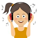 Cute teenager girl listening to music with headphones. Cute funny teenager girl listening to music with headphones Royalty Free Stock Photos