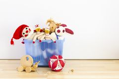 Assortment of cute vintage children toys. Cute and funny vintage children toys in a blue plastic box in front of a white wall. Assortment consists of a buffoon stock images