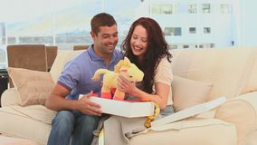 Cute future parents with a baby game Royalty Free Stock Image