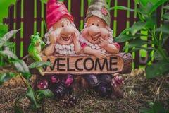 Cute garden gnome model royalty free stock photography