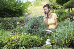 Cute gardener with fresh herbs Stock Images