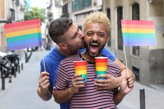 Cute gay couple partying outdoors royalty free stock photography