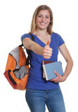 Cute german student with books showing thumb up Royalty Free Stock Images