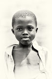 A cute Ghanaian boy poses for the camera Stock Images